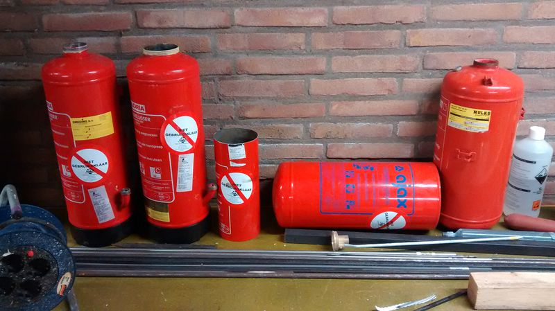 File:Chopped extinguishers.jpg